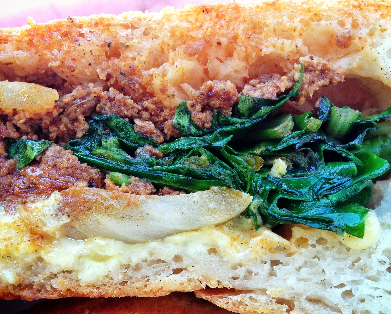Egg,  chorizo and sauteed greens breakfast sando at Santa Monica farmer's market
