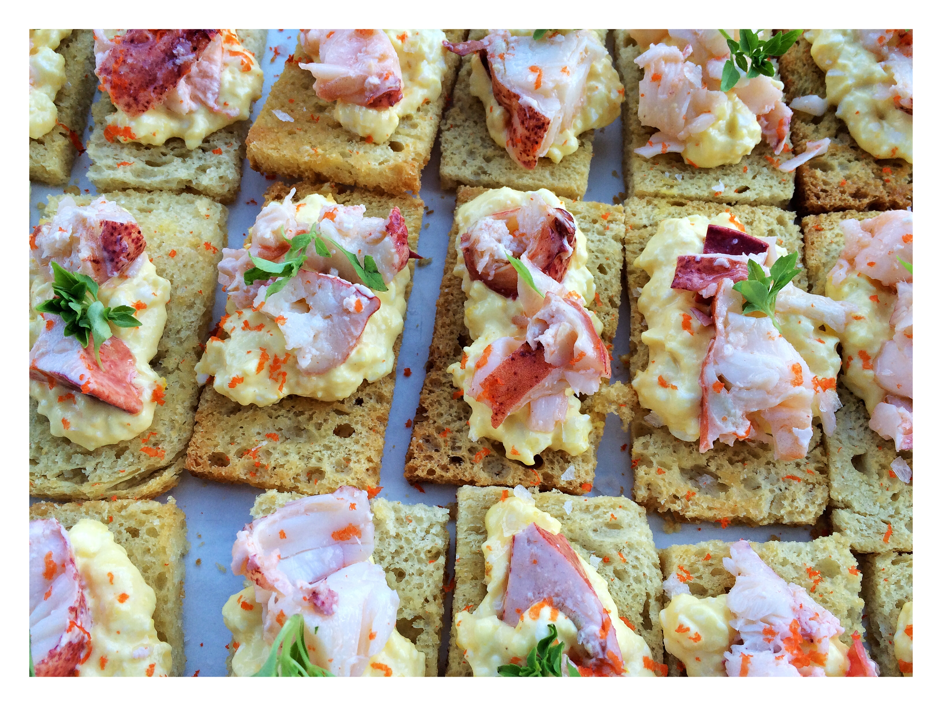 Lobster pieces, roasted lobster roe, micro basil & sea salt atop creamy egg salad on buttered brioche toast