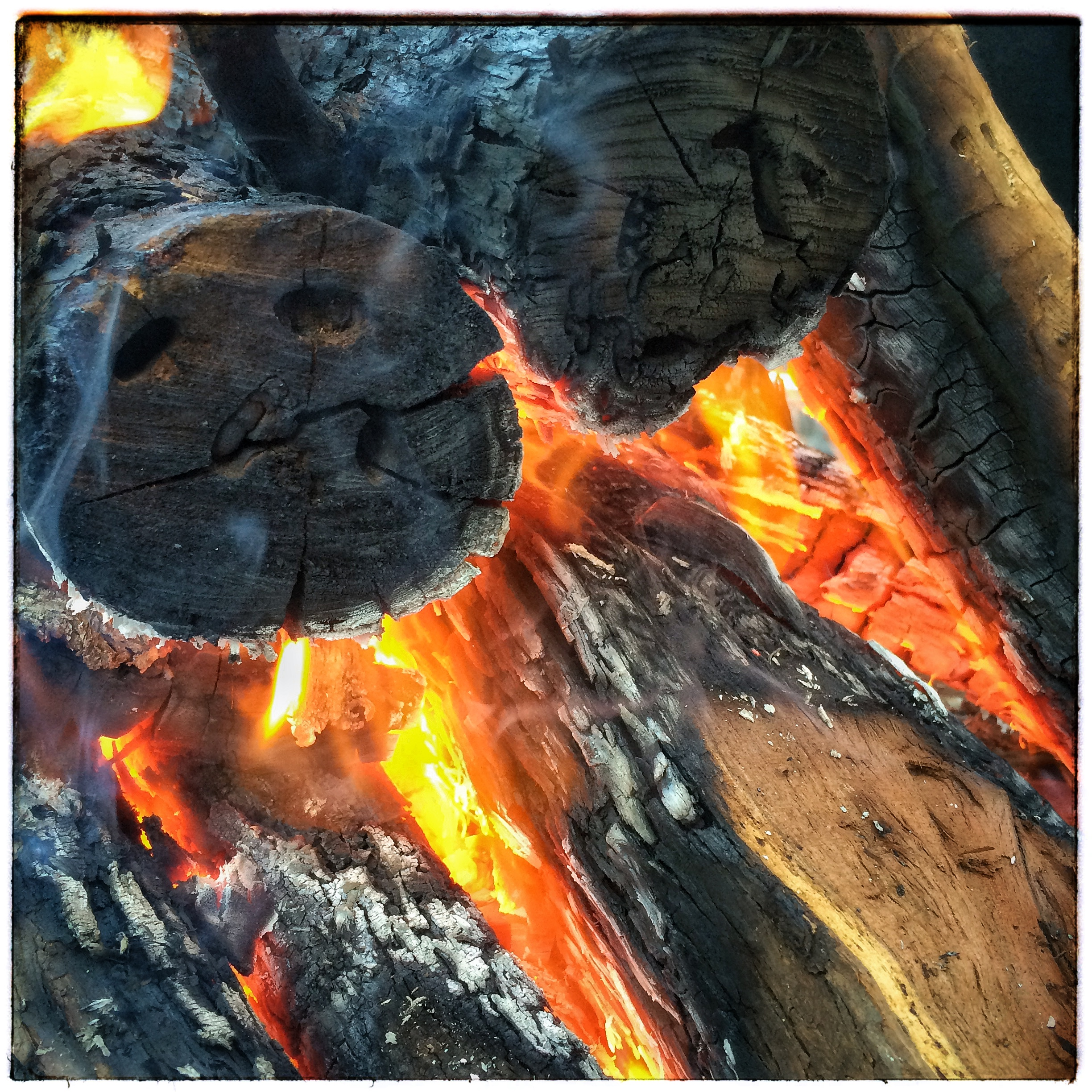 Mesquite Logs Catching Fire under the Grill