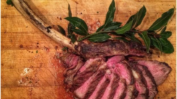Rested and Sliced, the Steak with Bay Leaf Branch Awaits its Platter and Trip to the Table