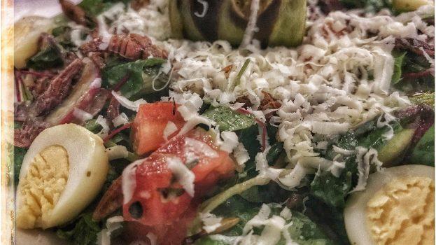 creole zucchini, tomato, cactus, chochoyotas, quail eggs, prensa cheese and grasshopper salad